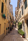 Narrow Street with Lady Sweeping  Old Town  Corfu Town