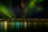 Aurora Borealis or Northern Lights over Reykjavik Skyline  Reykjavik  Iceland