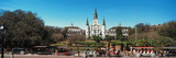 Horsedrawn Carriages on the Road with St Louis Cathedral in the Background  Jackson Square