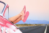Freedom Car Travel Concept - Woman Relaxing with Feet out of Window in Cool Convertible Vintage Car