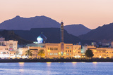 Oman  Muscat Mutrah Harbour and Old Town at Dusk