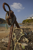 An Old Anchor Next to Crab Pots Piled Up Beside the Harbor in Port Isaac  Near Padstow  Cornwall
