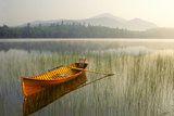 An Adirondack Guide Boat in a Calm Lake with Whiteface Mountain in the Background Papier Photo par Michael Melford