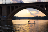 Paddleboarders Glide on the Potomac River under the Key Bridge in Georgetown