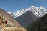 A Mountain Biker Cycles Along a Trail in the Tsum Valley in Nepal