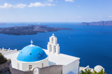 Blue Dome and Bell Tower Above Aegean Sea