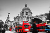 St Paul's Cathedral in London  the Uk Red Buses in Motion and Man Walking with Umbrella