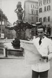 A Man Reads the Newspaper the Republican Voice in Front of the Fountain of the Triton