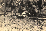 Injured Soldier Lying on a Stretcher  Aided by Some Companions