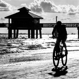 Cyclist on a Florida Beach at Sunset
