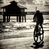 Cyclist on a Florida Beach at Sunset