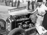 Attilio Marinoni  Chief Mechanic of Scuderia Ferrari  with an Alfa Romeo  1934
