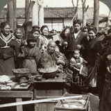 A Street Performer with a Monkey Amusing the Crowd  Kobe  Japan  1896