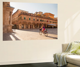 Woman Cycling Through Piazza Del Popolo  Ascoli Piceno  Le Marche  Italy