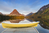 Boat on Calm Morning at Two Medicine Lake in Glacier National Park  Montana