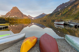 Boats on Calm Morning at Two Medicine Lake in Glacier National Park  Montana  USA