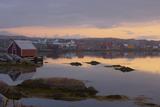 Fishing Village Along the Water's Edge at Sunset; Fogo Island  Newfoundland  Canada