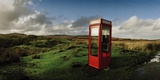 A Telephone Booth Standing Alone on a Remote Moor