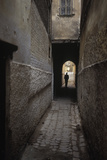 Silhouette of a Man Walking Through an Archway in Fez  Morocco
