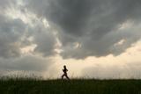 A Teenage Girl Runs in a Grassy Field Near Loma  Nebraska