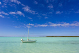 A Lone Sailboat Anchored in Turquoise Water