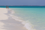 Two People Walking Down the Beach at Grace Bay on the Caribbean Sea