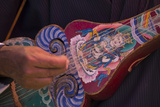 A Close Up of a Traditional Dranyen  a Lute Like Instrument