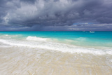 Storm Clouds Roll in over Turquoise Waters and a Beach