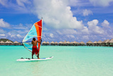 A Tourist Wind Surfing Off the Coast of Bora Bora