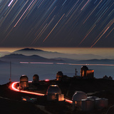 A Time-Exposure Image of the Setting Stars in a Moonlit Night in Form of Colorful Star Trails