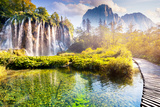 Majestic View on Waterfall with Turquoise Water and Sunny Beams in the Plitvice Lakes National Park