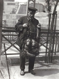 Two Young Orangutans Being Held Up by the Arms  by Keeper Rodwell  at London Zoo  April 1916