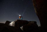 Joshua Tree National Park  California: A Young Couple Stargazing in the Desert on a Moonless Night