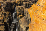 A Photographer Atop Sandstone Cliffs Above the King George River in the Kimberley Region