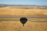 The Shadow of a Hot Air Balloon over Agricultural Fields  Irrigation Canals  and an Interstate