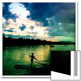 A Seven Year Old Girl Paddles a Paddle Board at Sunset on Sebago Lake