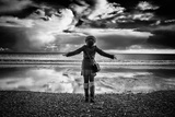 Young Girl Standing on a Beach Papier Photo par Rory Garforth