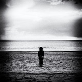 Female Figure Standing Alone on Beach Papier Photo par Rory Garforth