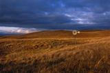 A Solitary Windmill Stands in a Remote Prairie Landscape