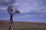 A Windmill in the Nebraska Sandhills Stands Tall over the Rolling Landscape