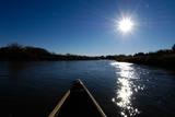 View of the Sun Shining on a River from a Canoe