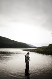 A Man Fly Fishes for Spawning Salmon in a Remote Inlet in Alaska