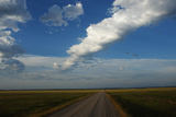 A Rural Gravel Road and Long Strings of Clouds