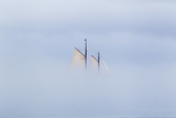 Low-Lying Fog Hides a Wooden Masted Schooner in Casco Bay
