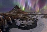 Strong and Colorful Aurora Borealis in the Foreground Is the Waterfalls and Kirkjufell Volcano