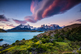 A Patagonia Scenic with the Andes Mountains  a Lake  Green Growth and Clouds