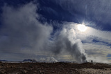 Steam from Geysers in Myvatn Geothermal Area  Northern Iceland a Volcano Is on the Horizon