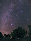 The Milky Way from Sirius to Constellations Orion  Taurus  and Auriga over a Tree and a Hut
