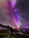 A Woman Enjoys the Aurora Borealis  Bursting in Colorful Rays Venus Is at the Lower Right