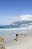 A 20-25 Year Old Young Brazilian Woman on Ipanema Beach with the Morro Dois Irmaos Hills